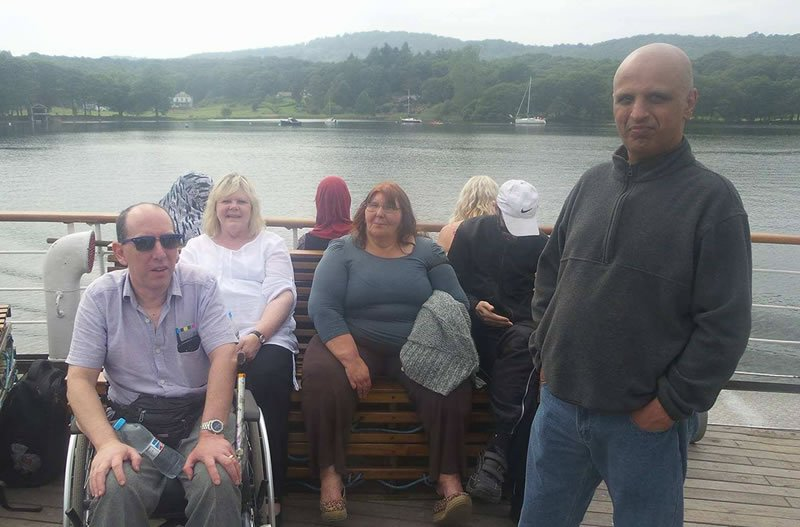 disabled people gathered together on holiday on a boat