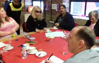 group advocacy photo for disabled people gathered around a large table