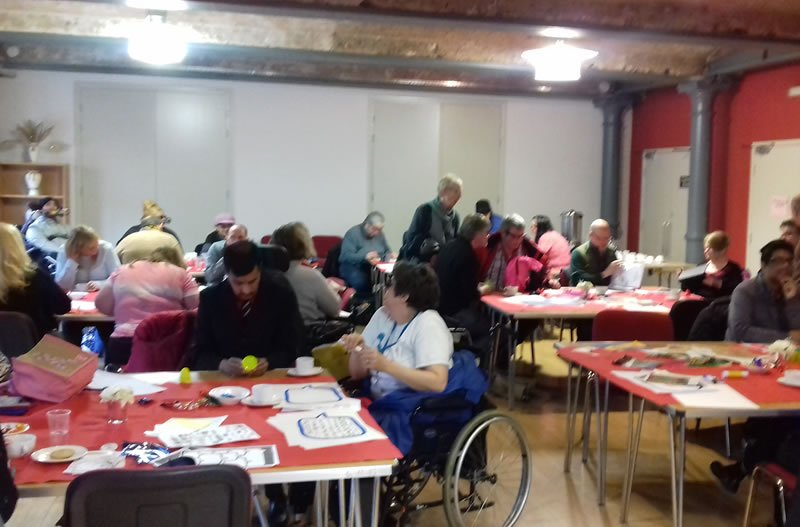 group advocacy photo for disabled people in a large room
